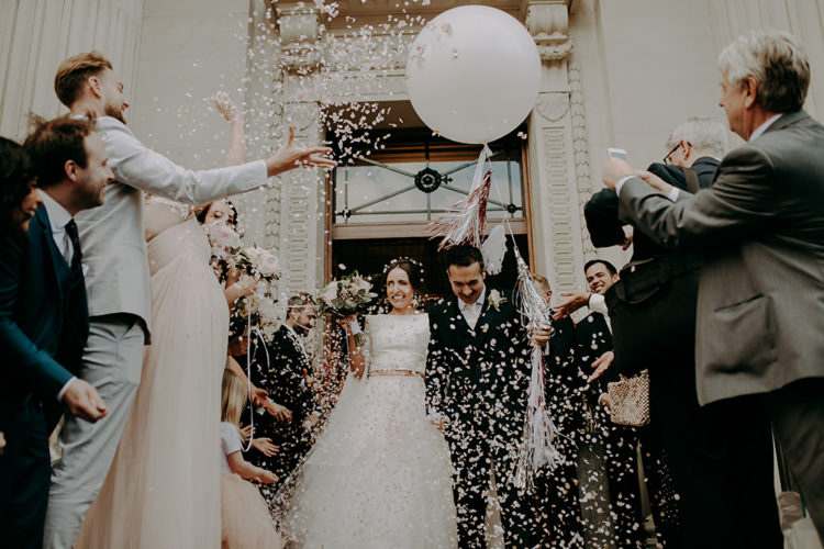 The couple was having fun at each stage of the wedding, there were petals and balloons