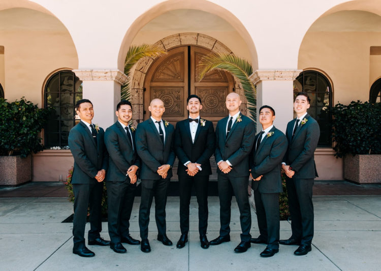 The groom was rocking and tuxedo and the groomsmen were wearing suits with ties