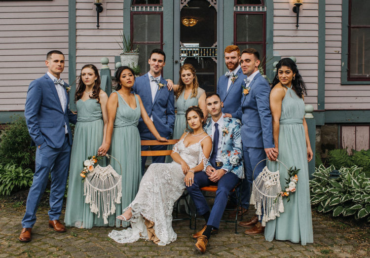 The groomsmen were wearing blue suits, bright printed bow ties, brown shoes that matched the groom's pants' color