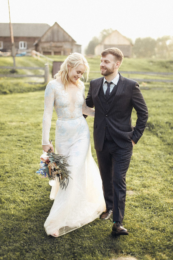 The wedding dress was done with white and blue lace, long sleeves and a covered plunging neckline