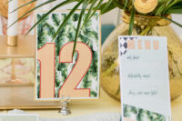 wedding table numbers with tropical leaves