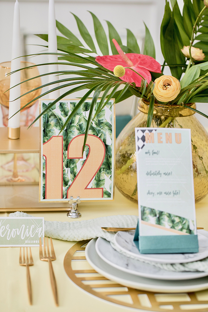 Bright tropical floral and greenery arrangements added fun to the tablescape