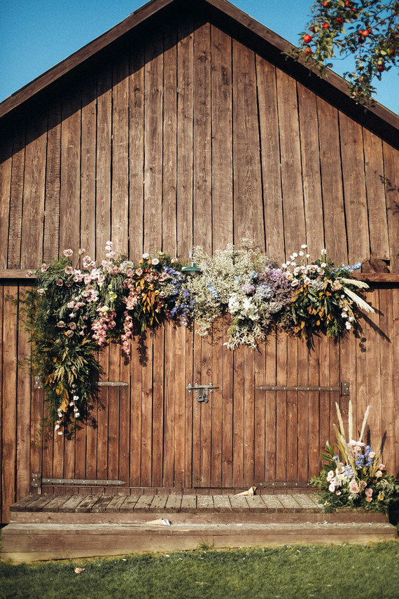 The barn was decorated with bright blooms and lots of textural greenery to create a backdrop