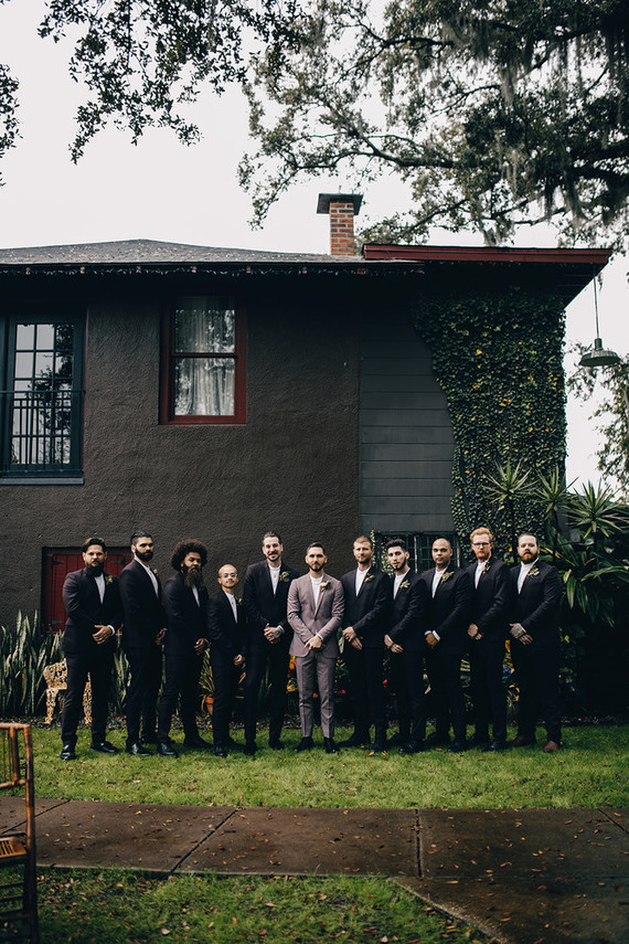 The groomsmen were rocking black suits and white shirts
