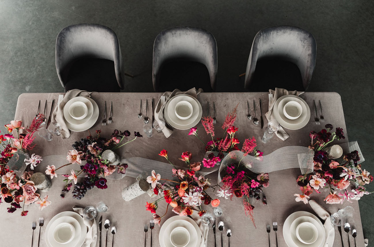 The tablescape was done with a neutral tablecloth, bright florals and neutral tableware