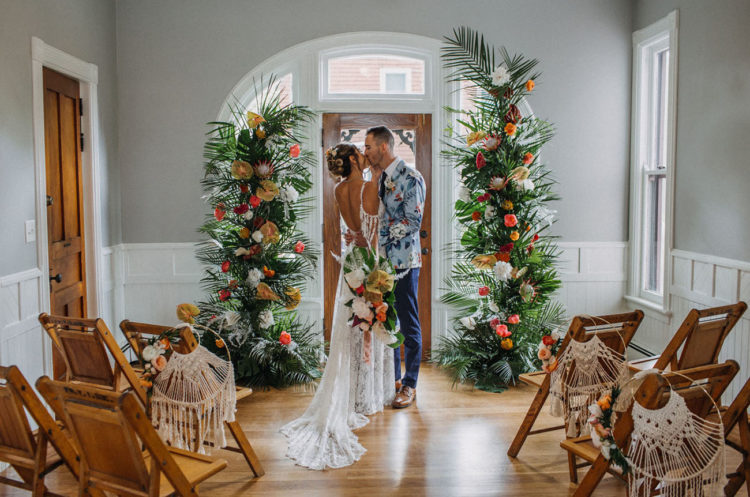 The wedding altar was done with bright tropical blooms and fronds to highlight the tropical aesthetics of the day
