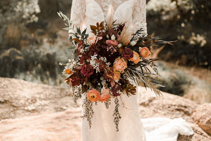 The wedding bouquet was very textural and dimensional, with greenery and grasses