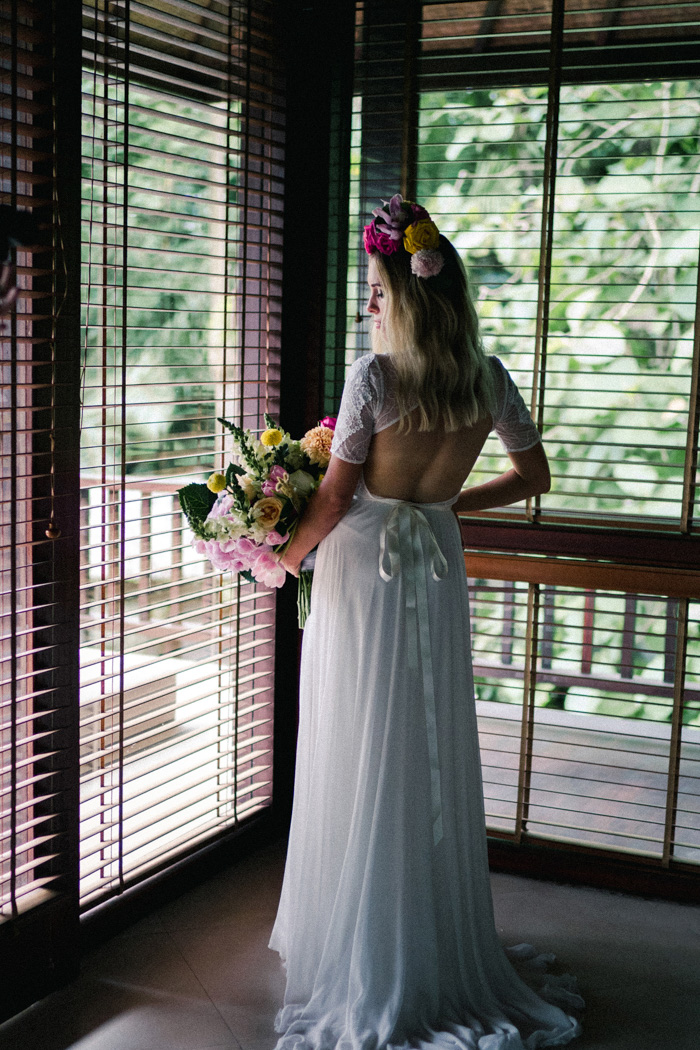 The wedding dress was with a lace bodice, a cutout back and a skirt with a train