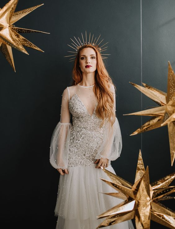 a spiked bridal tiara with some stars and a matching embellished wedding dress for a modern celestial bride