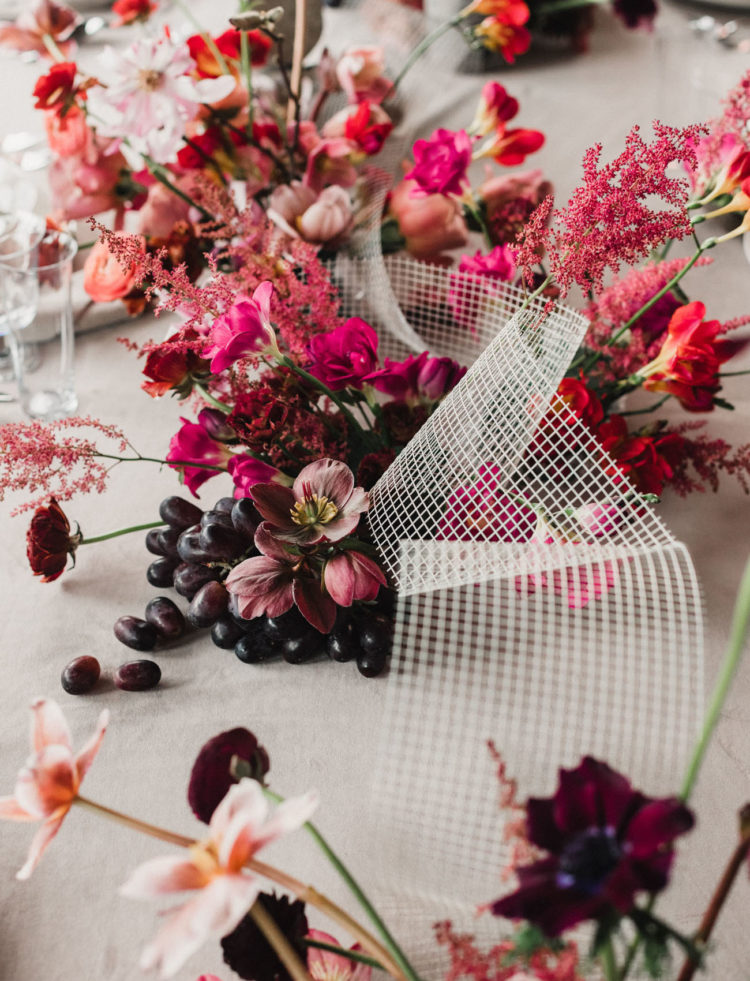 The table was decorated with bright blooms, herbs and even grapes