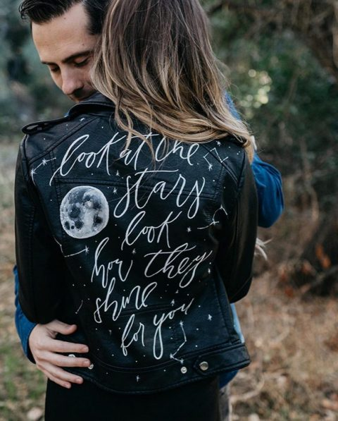 cover up with a black leather jacket with calligraphy and a moon to look wow