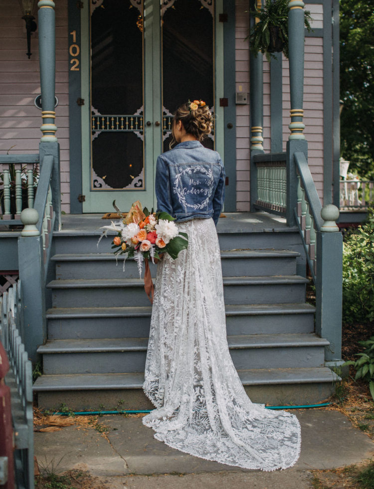 The bride covered up with a blue denim jacket that was personalized for her