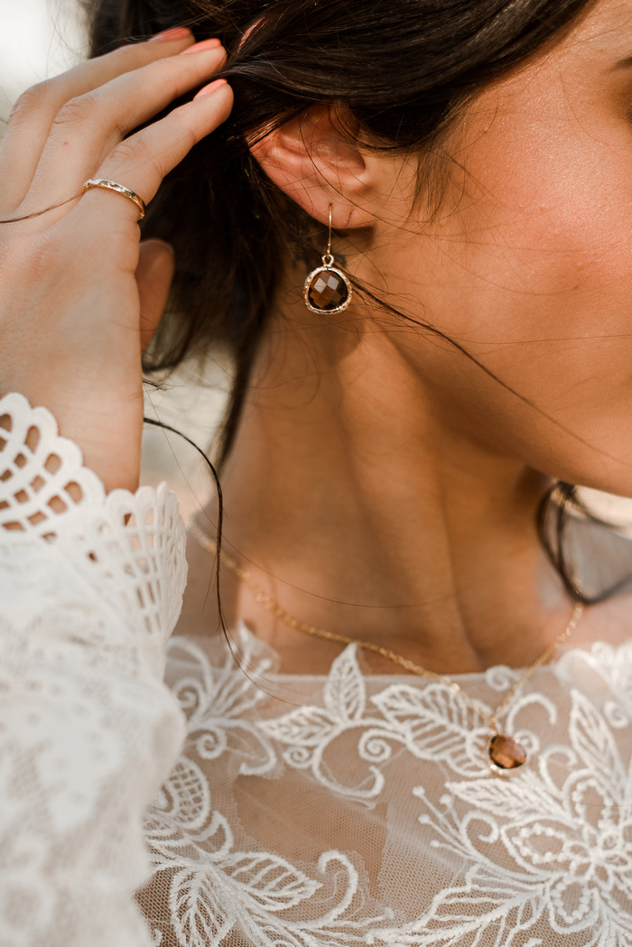 The bride was rocking beautiful cognac colored jewelry