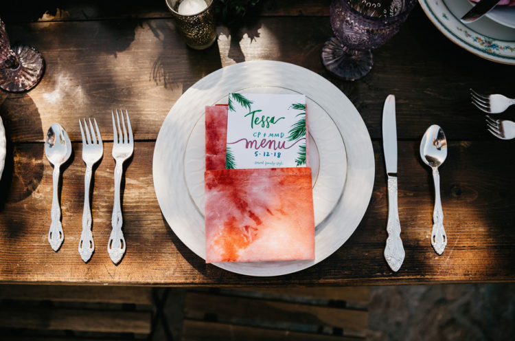 The napkins were hand-dyed and the menus hinted on the location of the wedding