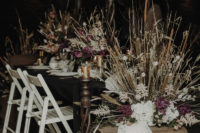 08 The wedding venue was decorated with pink blooms, dried herbs and leaves and dark candles