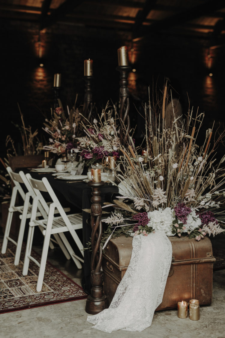 The wedding venue was decorated with pink blooms, dried herbs and leaves and dark candles