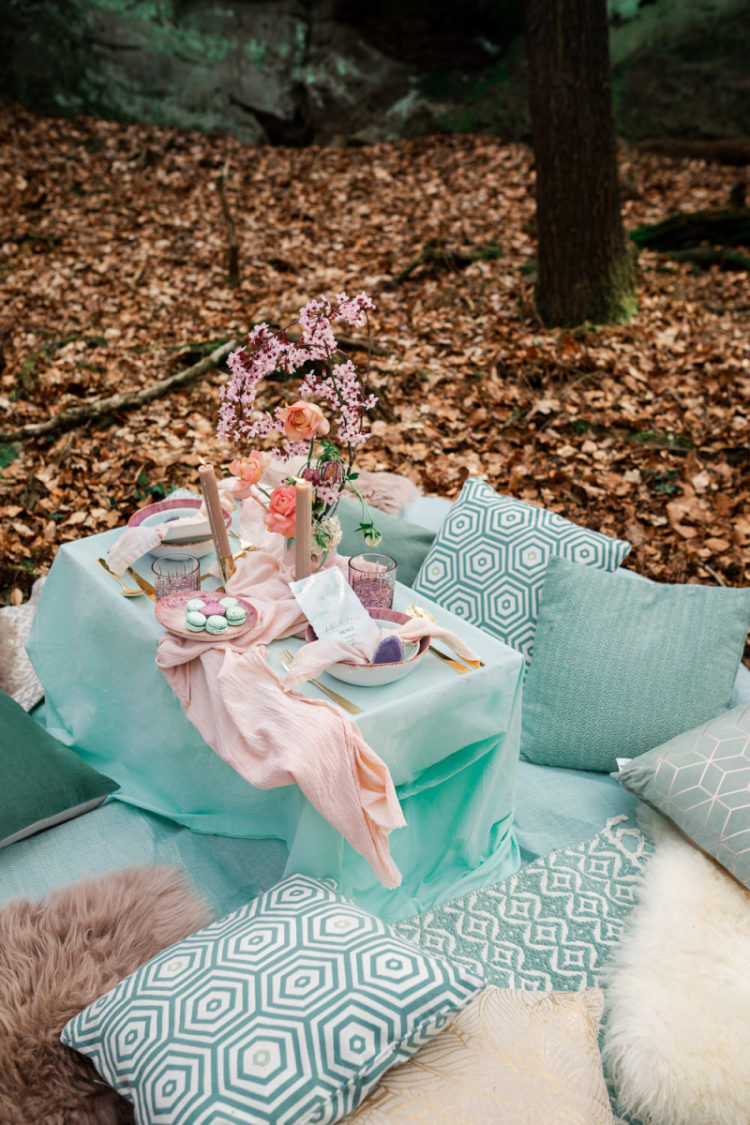 There was a picnic setting in pastels created for the couple, with lots of pillows, blooms and candles