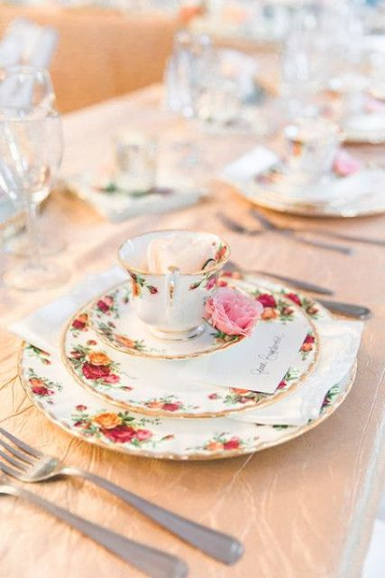 a floral vintage wedding reception place setting done with chic china and a single pink garden rose