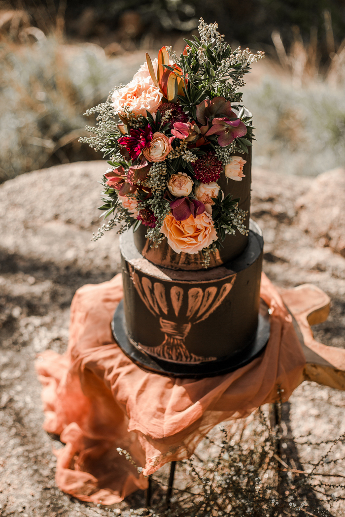 The second wedding cake was a black one with handpainting and fresh blooms