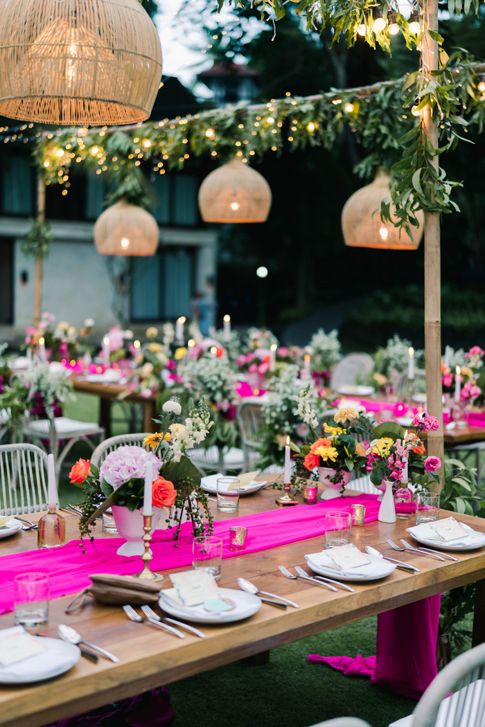 The tablescapes were decorated with neon pink runners, bright blooms and touches of gold