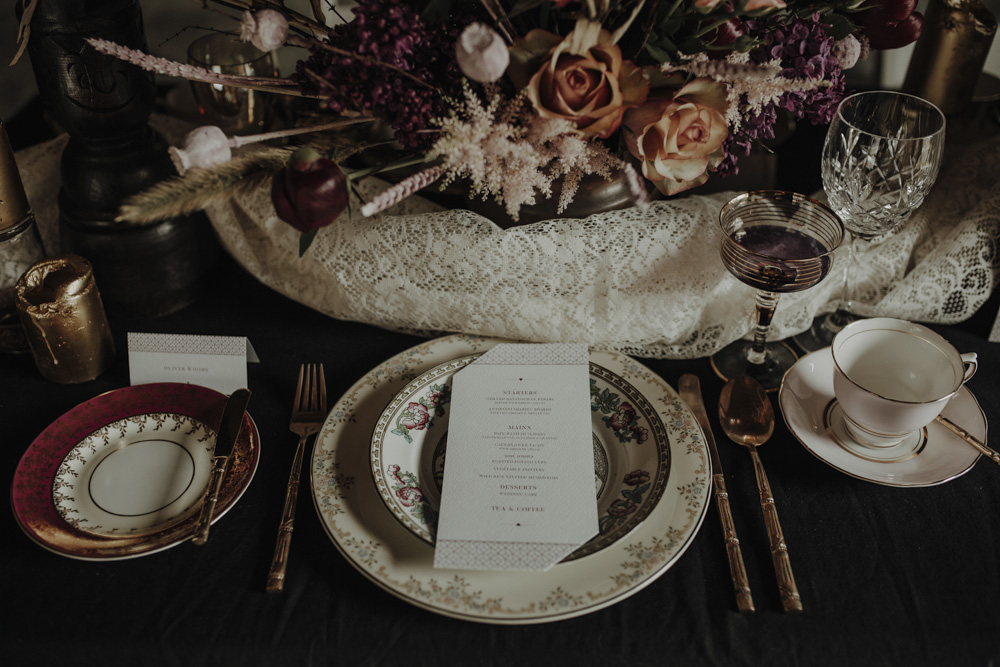 The wedding tablescape was a combo of elegant porcleain, gilded touchesm candles and fantastic florals