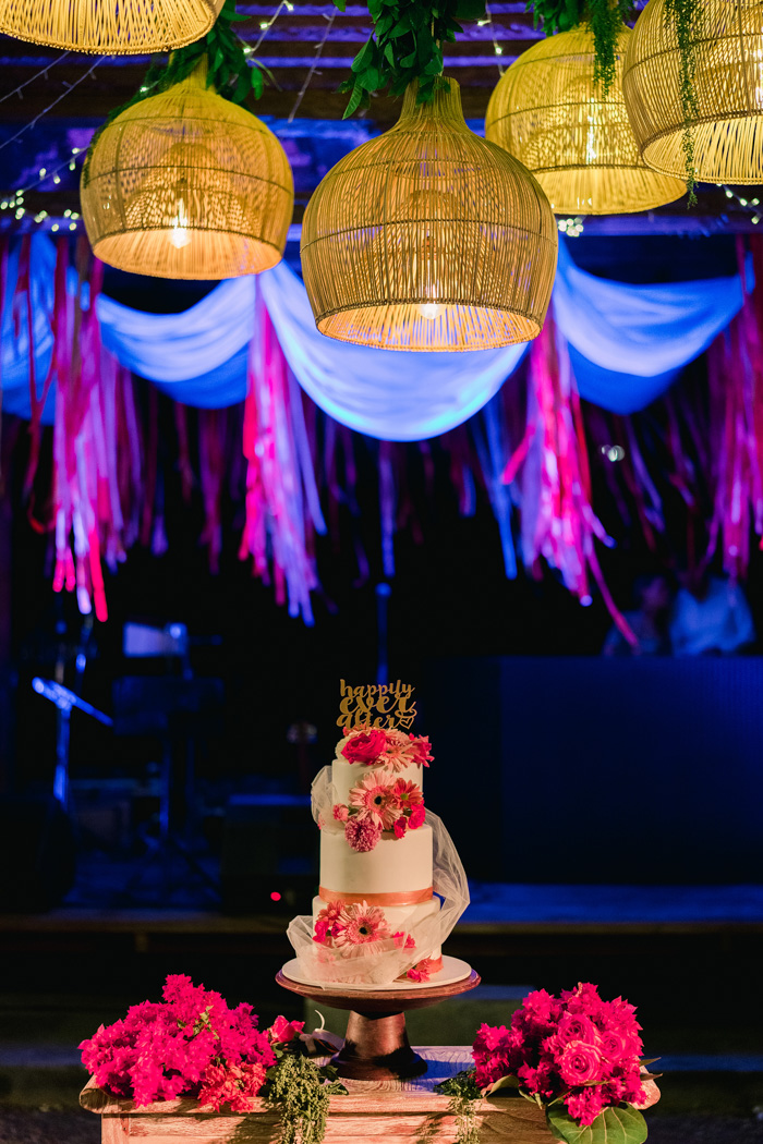 The wedding cake was decorated with a veil, bright blooms and a gold topper
