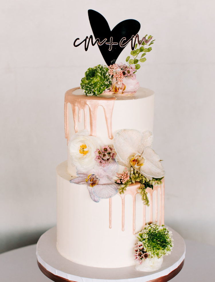 The wedding cake was decorated with fresh blooms and copper drip and looked amazing