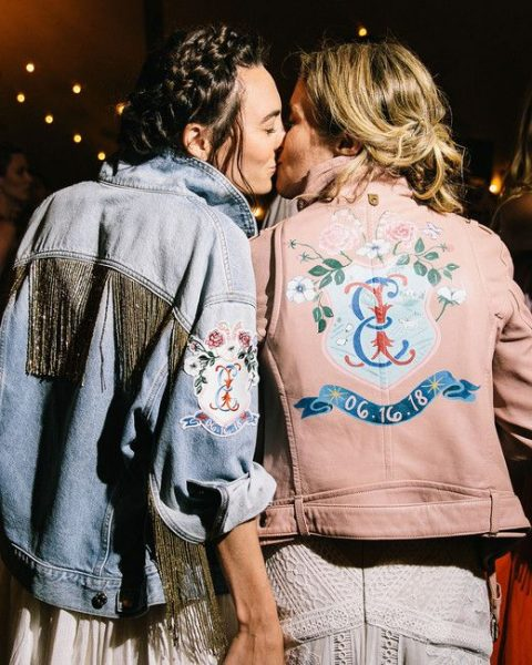 personalized bridal jackets – a blue applique denim one with logn gold fringe and a pink leather one with handpainting