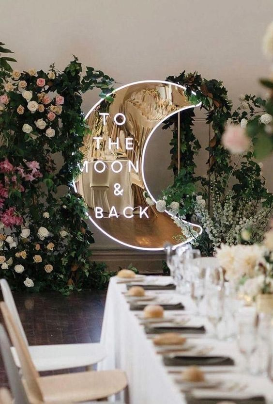 a half moon neon sign with a metallic gold base is a super cool idea for a celestial wedding