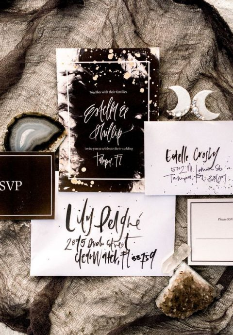 a black and white celestial wedding invitation suite with catchy letters and shiny touches for a modern celestial wedding