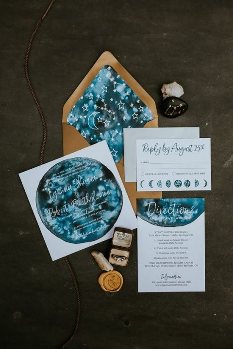a bold blue and rust wedding invitation suite done with watercolor and moon phases