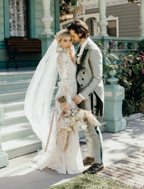a unique embellished spiked crown with a long veil and statement earrings to accessorize a gorgeous wedding dress right