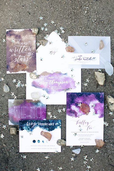 a dreamy purple, blue and glitter wedding invitation suite done with watercolors