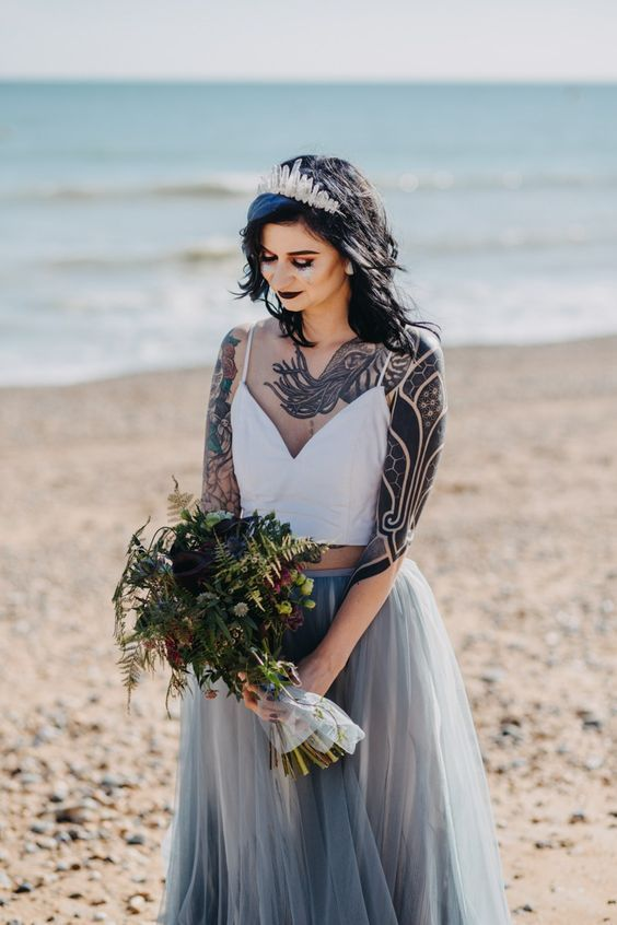 a dark lip and plenty of ink shown gives a bold and chic feel to the bridal look