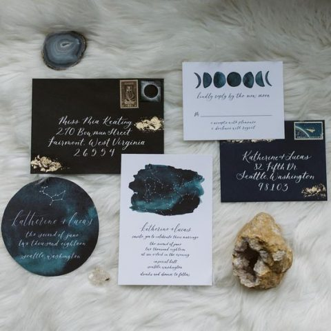 a stylish celestial wedding invitation suite done in navy, teal and with constellations and moon phases