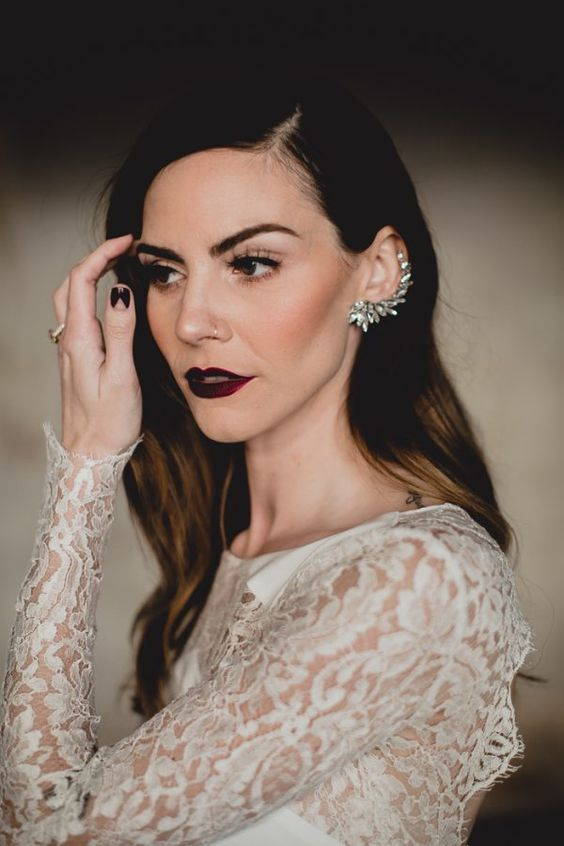 a gorgeous makeup with a dark lip, a rhinestone cuff and black nails make the bridal look super edgy