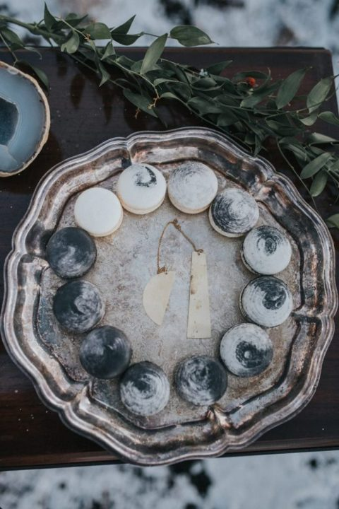 watercolor grey and white macarons that are showing the phases of the moon are amazing for your wedding dessert table