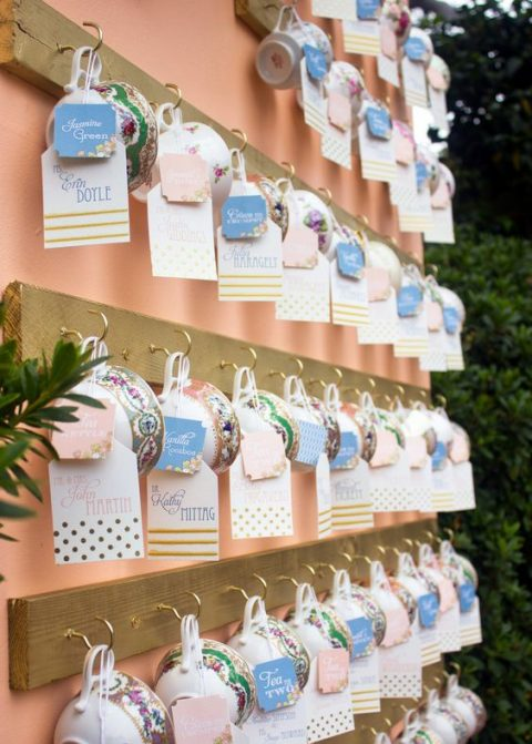 vintage teacups double as escort cards and wedding favors, such an idea will also fit a bridal shower