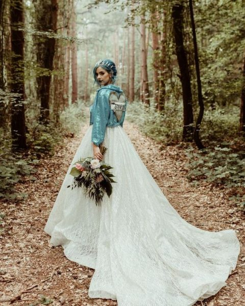 a romantic bridal look made edgy with an aqua sequin jacket and aqua-colored hair topped with a crown