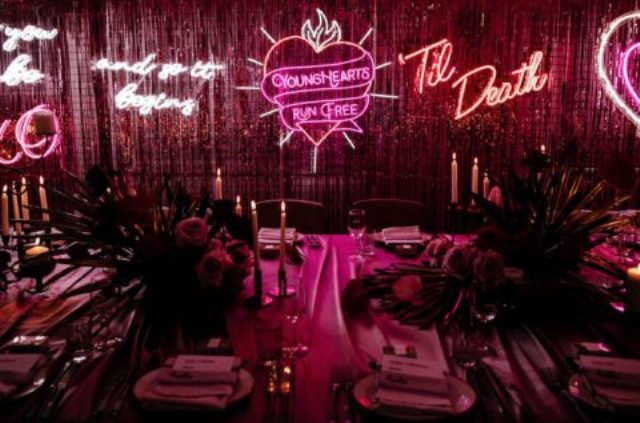 gorgeous neon signs for the wedding reception decor spruce up the moody and bold venue
