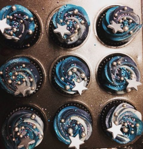 watercolor navy and blue swirl wedding cupcakes with beads and stars on top for your dessert table
