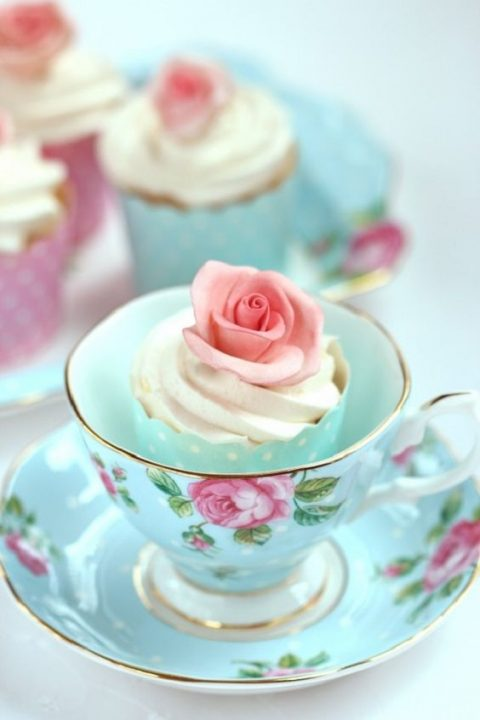 cupcakes served in vintage teacups is a very creative and chic idea for a vintage wedding