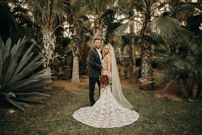 This couple went for a gorgeous moody tropical wedding with plenty of edgy details