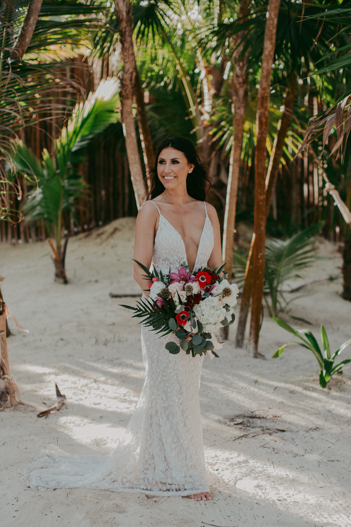 The bride chose a wonderful sheath embellished wedding dress with a plunging neckline and a train, waves and statement earrings