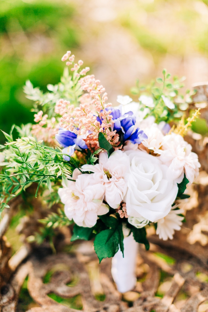 The wedding bouquet was done with white, blush and purple blooms and lots of textural greenery and blooms