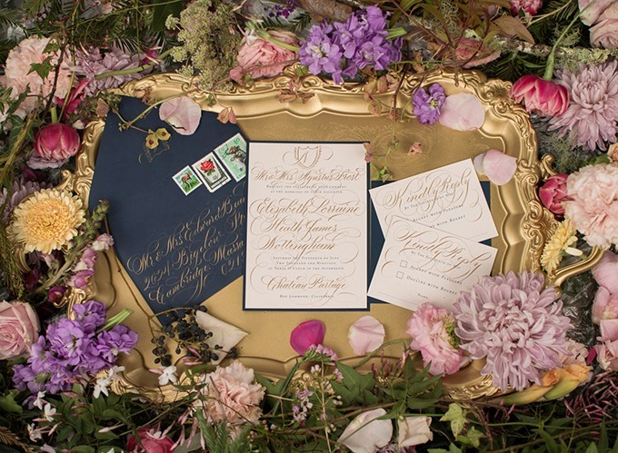 The wedding invitation suite was done in navy, creamy and with gold calligraphy that reminds of old fairytale books