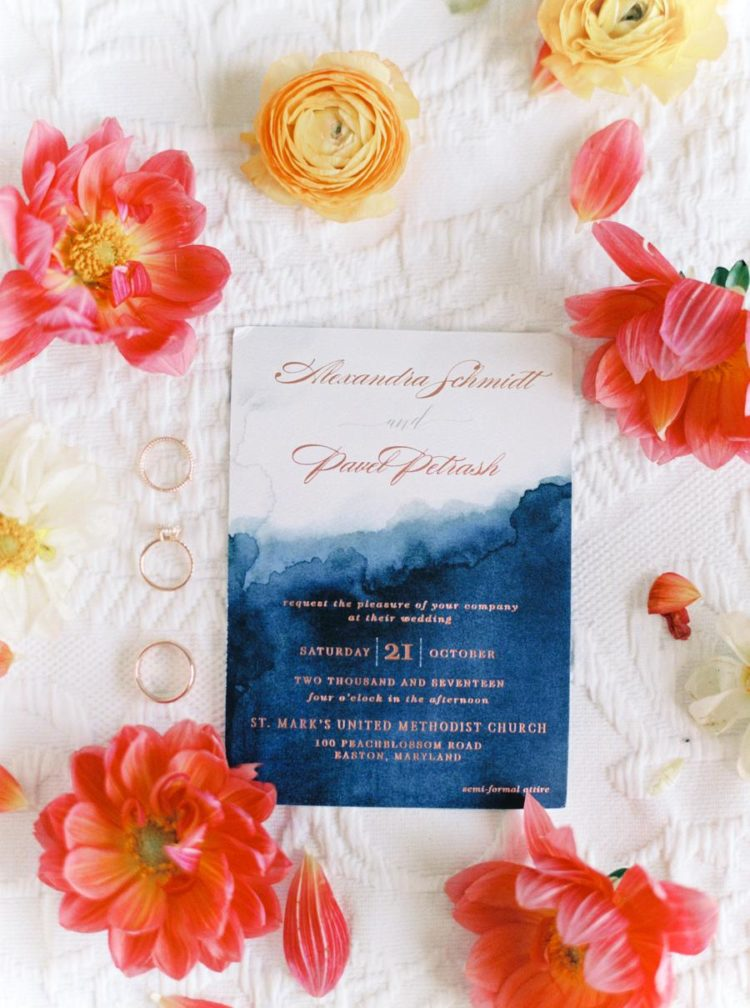 The wedding invitations were bright and ombre, with navy and copper