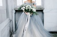02 a beautiful and romantic off the shoulder grey tulle wedding ballgown with statement earrings and a train