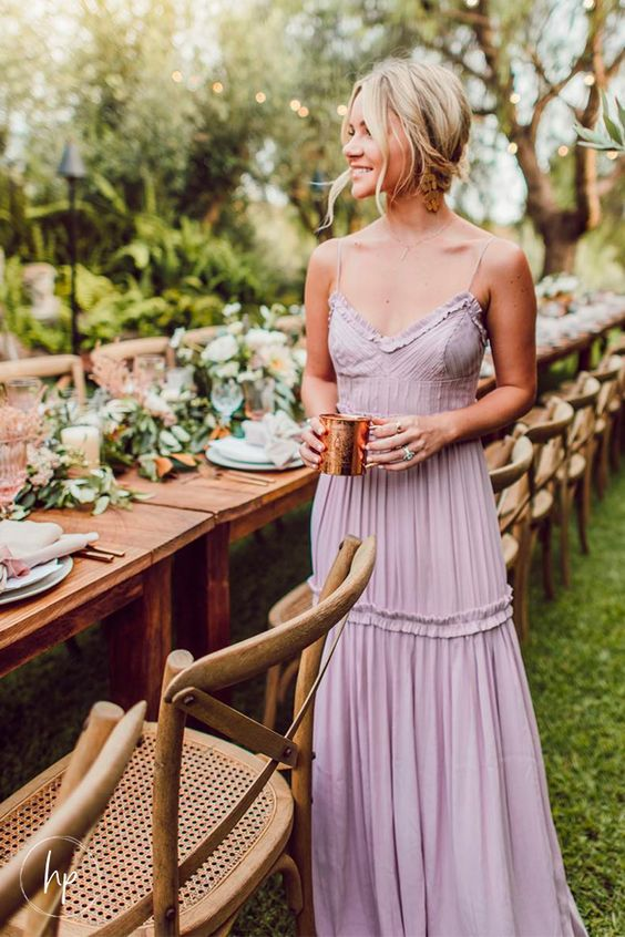 a cute mauve maxi dress with ruffles and on spagehtti straps is an amazing romantic idea for a summer wedding outdoors