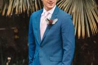 groom in a light blue tux
